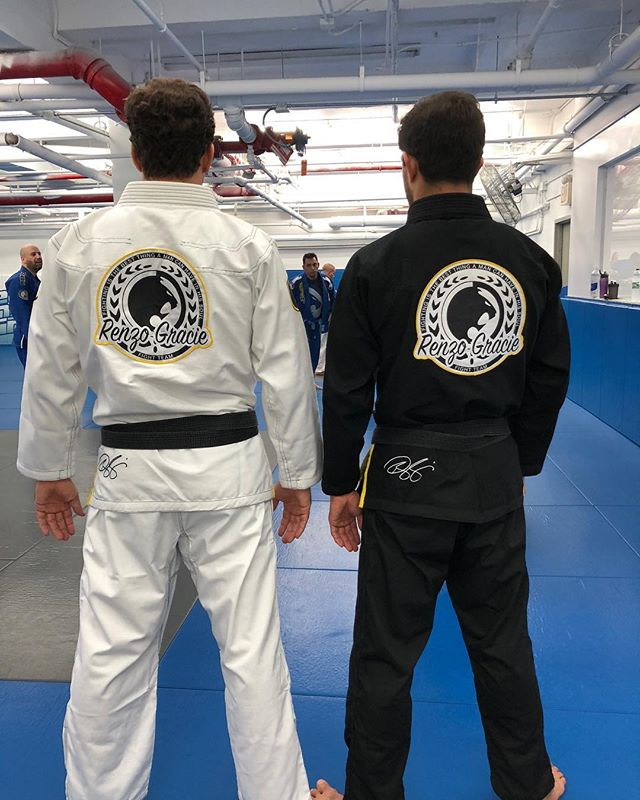 Two students wearing contrasting black and white Renzo Gracie Gis