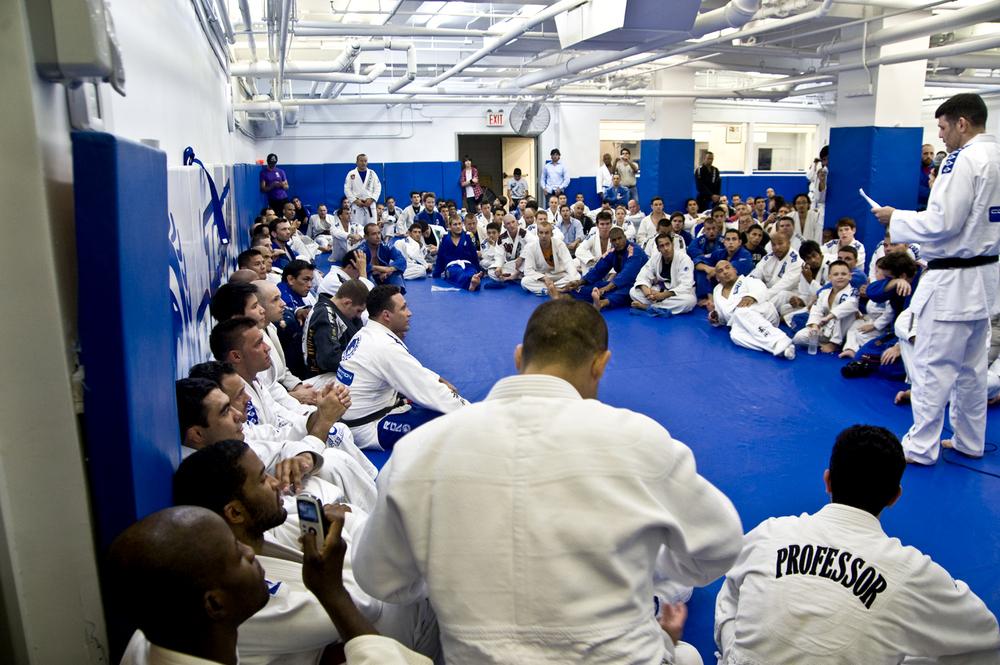 Brazilian Jiu-Jitsu students receiving their belt promotions